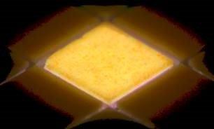 Prototype high-luminance LEDs in dense array, with center LED lit up.