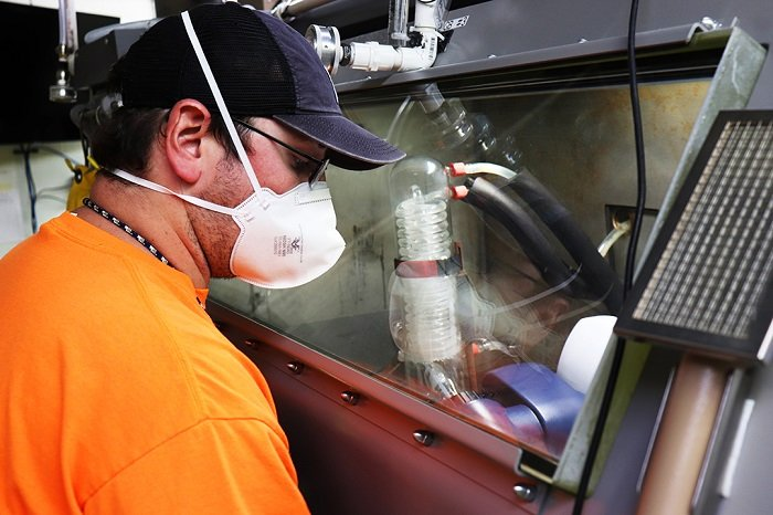 Employees, known as fissile material handlers, use shielded gloveboxes to dissolve uranium (U)-233 into a low-level form so it can be mixed with grout for safe transportation and disposal.