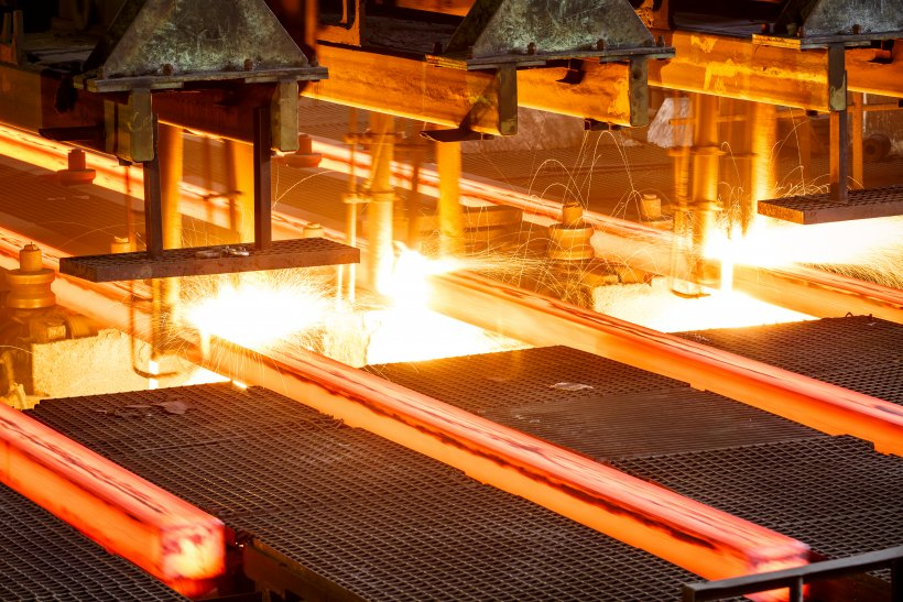 Hot steel going through conveyor belt at a steel manufacturing plant