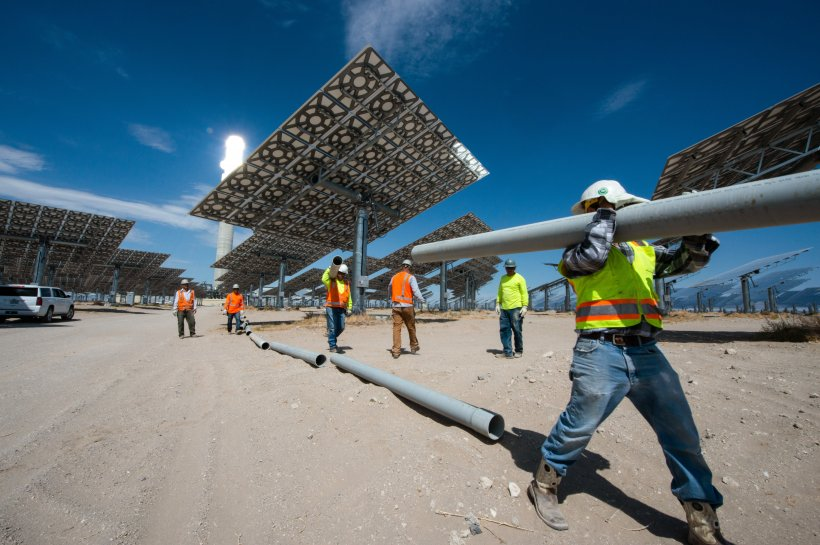 Contractors building a concentrating solar-thermal power plant.