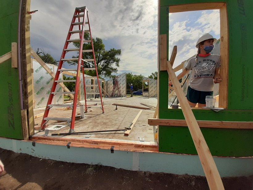 Kansas State University students return to work on building their solar house during the U.S. Department of Energy Solar Decathlon Build Challenge.