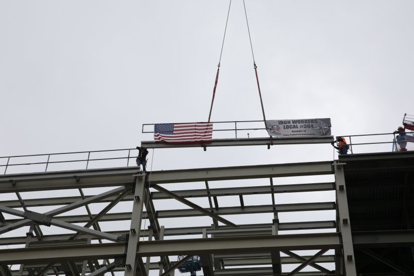 """The UPF Project places the last piece of structural steel on the Salvage and Accountability Building (SAB) during an Oct. 26 """"topping out"""" ceremony."""