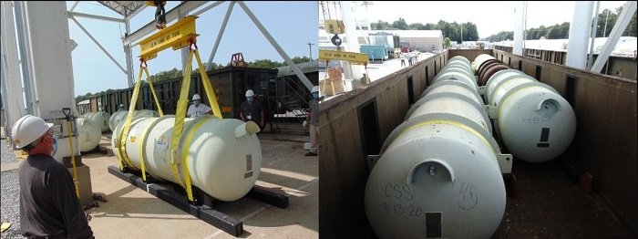 Workers at the Paducah Site load depleted uranium oxide cylinders onto a specialized railcar for shipment to the Waste Control Specialists Federal Waste Facility.
