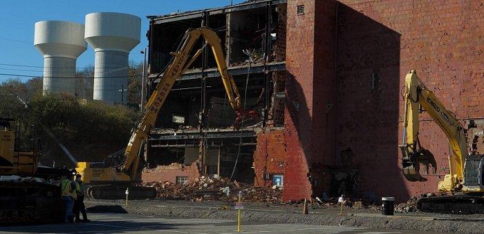 EM crews begin knocking down the three-story 65,000-square-foot Building 9210 at Oak Ridge on Nov. 16.