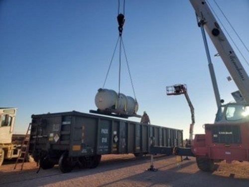 A Waste Control Specialists Federal Waste Facility crew in Texas offloads one of the first depleted uranium oxide cylinders to reach final disposition.