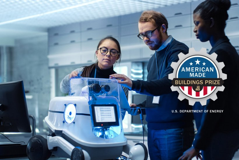 Photo of three people looking at a piece of machinery, with the American-Made Buildings Prize logo.