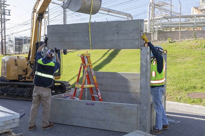 Workers dismantle transport platforms at the Y-12 National Security Complex so they can be taken to the Oak Ridge National Laboratory. The platforms will be installed to support deactivation activities at the eight-story Experimental Gas-Cooled Reactor.