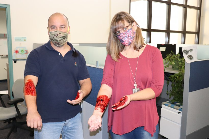 """NNSA employees Loren Torres and Cheri Ashe got the full moulage treatment from members of Kirtland Air Force Base's exercise team. The employees were just two of the """"victims"""" in the active shooter exercise."""