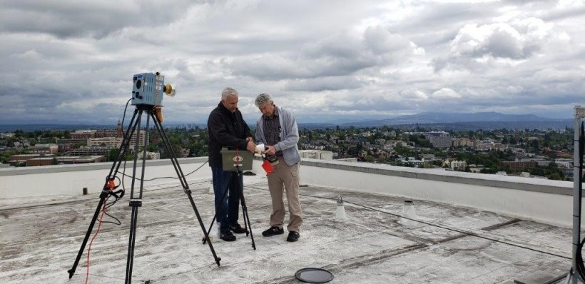 Experts test air samples on the roof of the Research and Training Building at the University of Washington as part of the cleanup process following a cesium breach at the facility.