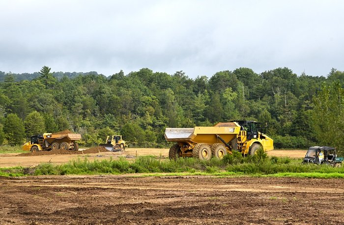 Crews place soil cover at a former oil tank farm site that once supported the K-770 Powerhouse.
