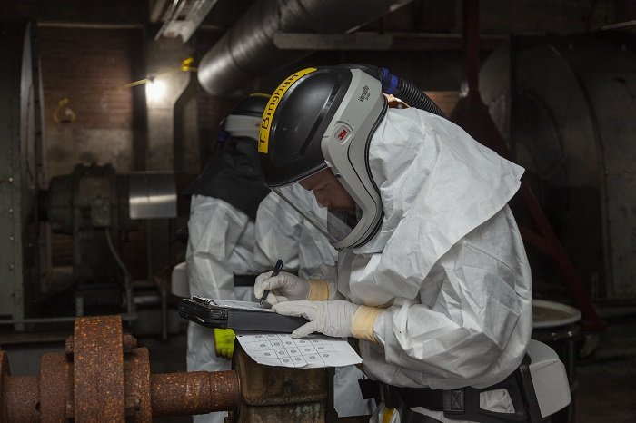 EM crews have transitioned from the successful completion of core cleanup at the East Tennessee Technology Park to projects at the Oak Ridge National Laboratory and Y-12 National Security Complex. Pictured are workers performing deactivation activities inside Manhattan Project-era facilities at Y-12.