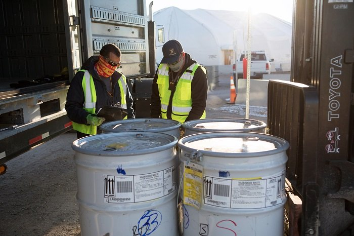 N3B employees prepare transuranic waste drums at Area G for transportation to the Los Alamos National Laboratory's Radioassay and Nondestructive Testing facility.