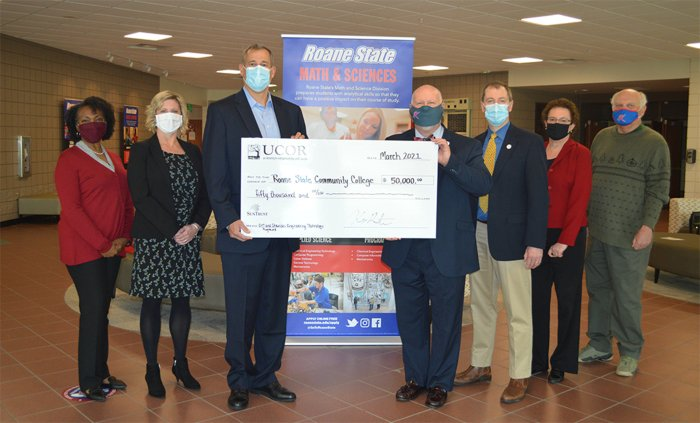 UCOR and Roane State Community College representatives celebrate the company's $50,000 donation that will be used for a new apprenticeship effort and to purchase equipment for the college's chemical engineering technology laboratory.