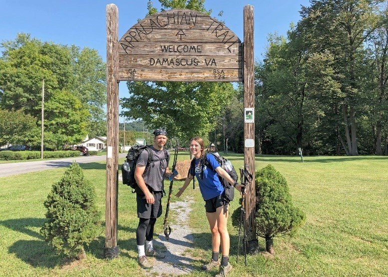 NNSA SRFO Classification Officer Bob Houck (left) and his daughter Reagan after arriving in Damascus, Virginia, in September 2020 having section hiked the Georgia, North Carolina, and Tennessee portions of the Appalachian Trail together.
