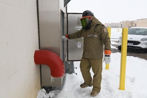 A Pantex electrician inspects connections related to the High Pressure Fire Loop tank heater.