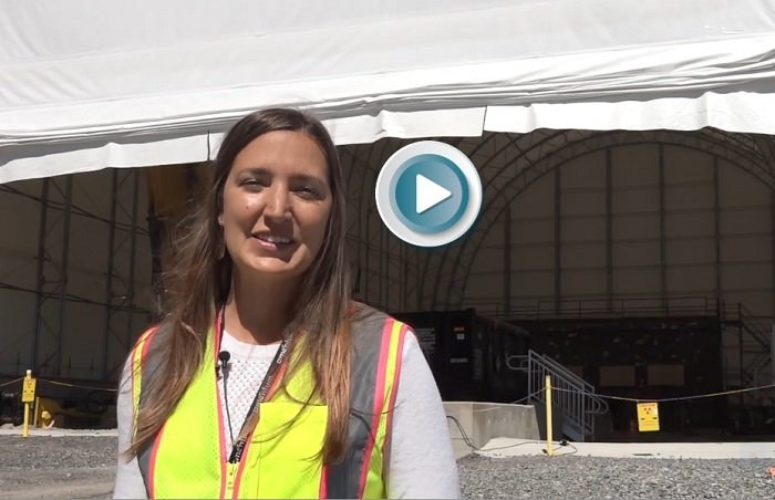 In this video about a demolition project at the former Radioisotope Development Lab, Susan Reid, pictured, a project manager with UCOR, discusses a six-story protective cover workers built over the facility's hot cells to ensure nearby research facilities are not impacted during the demolition.