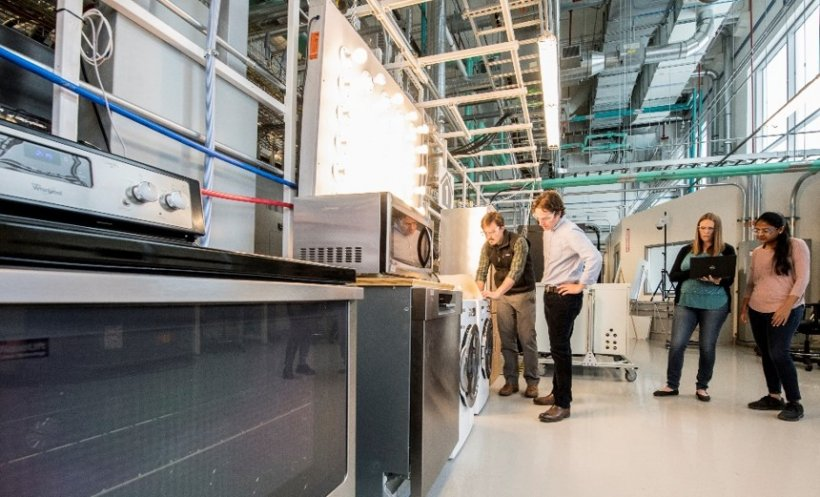 NREL researchers working in the System Performance Laboratory at the Energy Systems Integration Facility.
