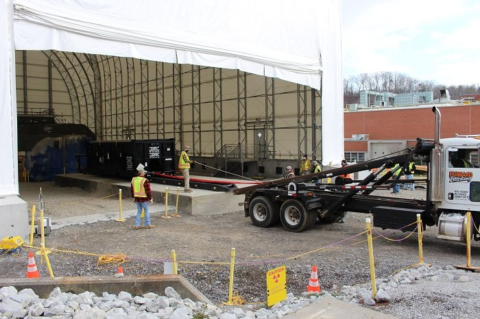UCOR installed a unique intermodal rail system designed by engineers. The system provides a safe way to remove demolition debris from a space-limited tent area at the former Radioisotope Development Lab.