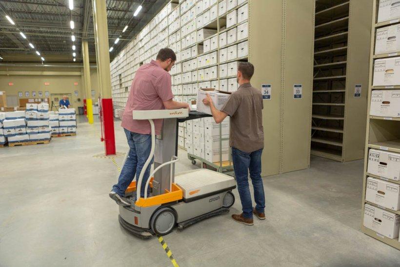 LM Strategic Partner staff shelve records materials.