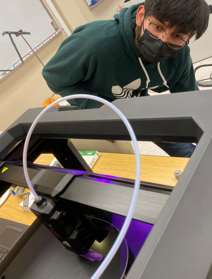 Engineering student Moises Trevino checks on the status of a chain being printed in the New Mexico State University Carlsbad engineering laboratory.
