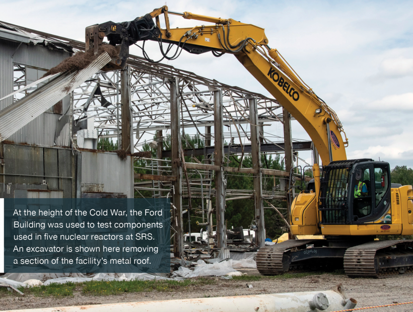 At the height of the Cold War, the Ford Building was used to test components used in five nuclear reactors at SRS. An excavator is shown here removing a section of the facility's metal roof.