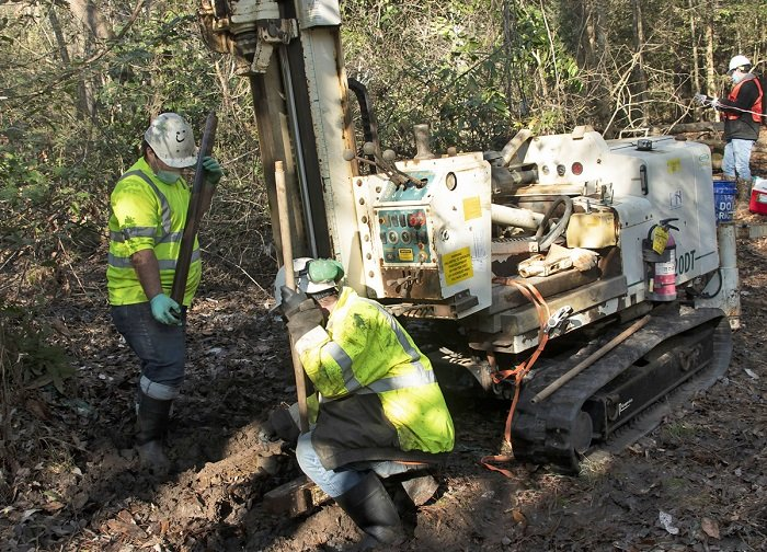 Savannah River Nuclear Solutions subcontractors drill for soil samples as part of a project to immobilize iodine-129 in the groundwater and soil at the Savannah River Site. Pictured are Donald Miles and Richard Mooney with Cascade Drilling Company.