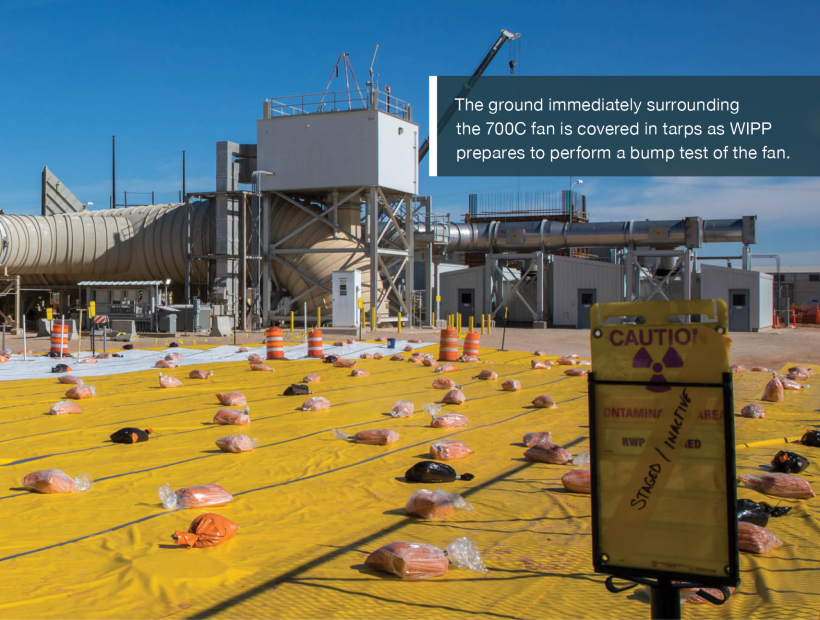 The ground immediately surrounding the 700C fan is covered in tarps as WIPP prepares to perform a bump test of the fan.