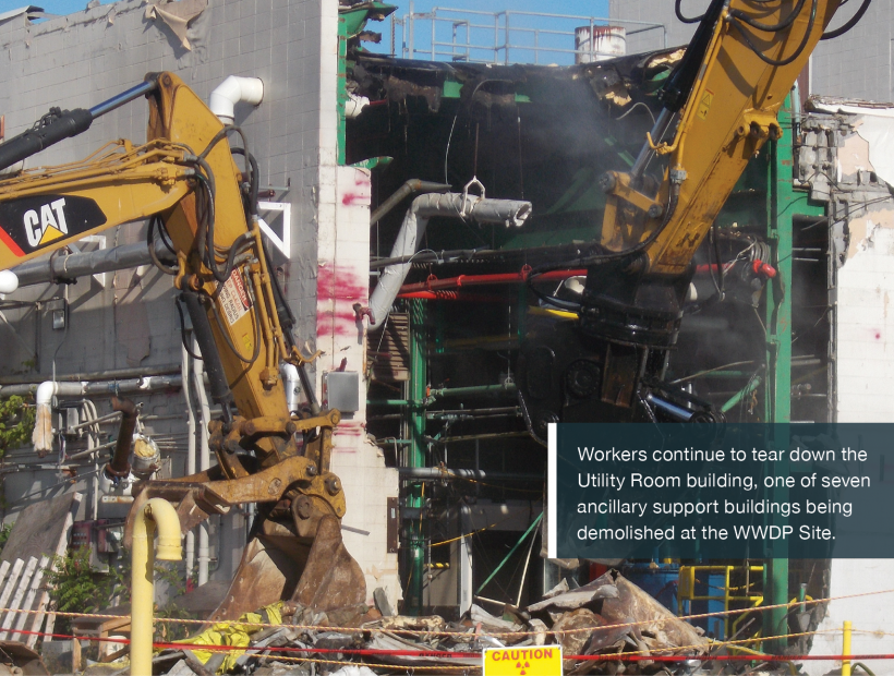 Workers continue to tear down the Utility Room building, one of seven ancillary support buildings being demolished at the WWDP Site.