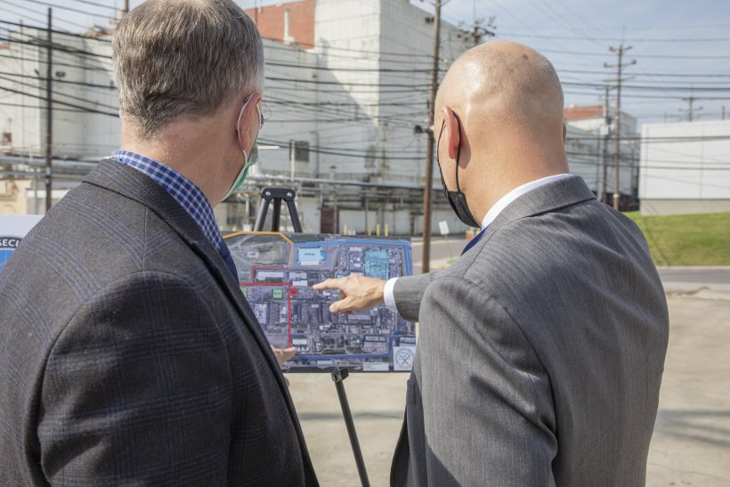 Officials examine a site plan for the WEPAR project at Y-12 National Security Complex.