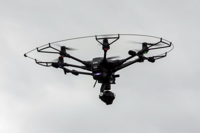 A camera-mounted drone soars above the Savannah River Site as it inspects engineered protective covers at EM's remediated waste sites.
