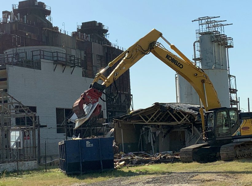 Crews with CTI and Associates, a protégé and subcontractor to Savannah River Nuclear Solutions, demolishes a building near the former D Area Powerhouse at the Savannah River Site.