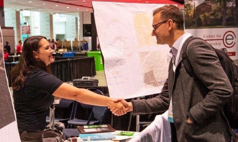 Members of the wind industry shake hands.