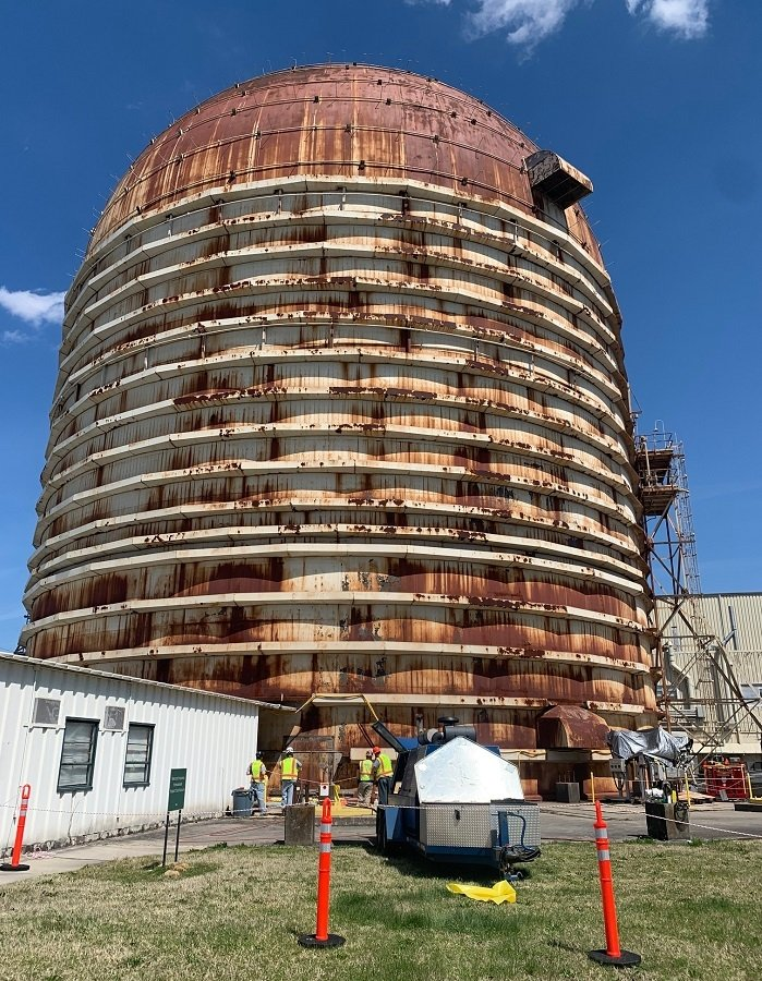 Crews prepare the Experimental Gas-Cooled Reactor for deactivation. The eight-story facility at the Oak Ridge National Laboratory stands 216 feet tall.
