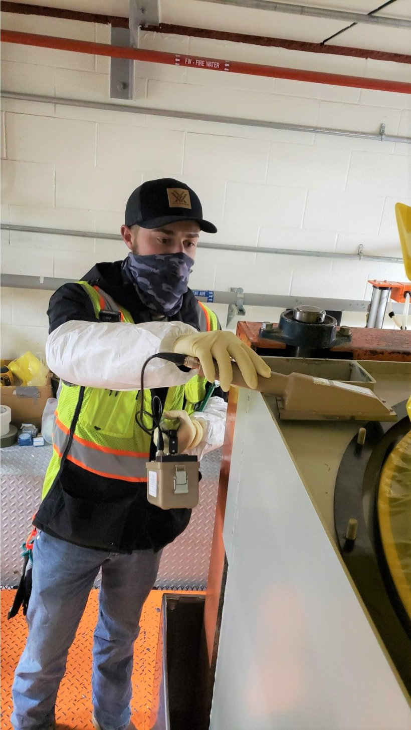 Ethan Hoopes, a radiation control technician for EM contractor Fluor Idaho, surveys a piece of equipment at the Advanced Mixed Waste Treatment Project at the Idaho National Laboratory Site.
