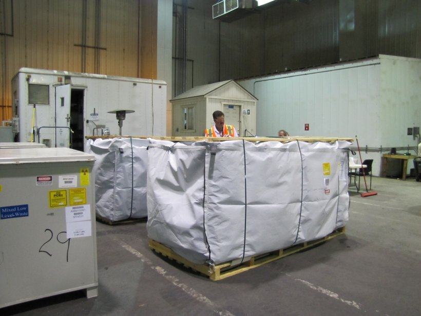 Fluor Idaho waste disposal and waste generator services manager inspects a waste shipment before it is loaded on a tractor trailer for disposal at an off-site facility