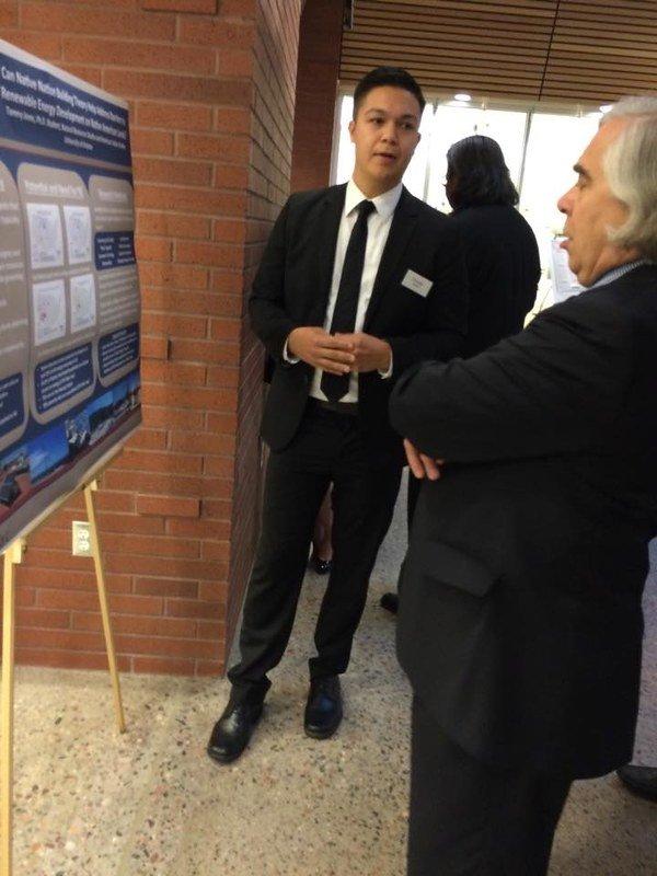 Tommy Jones presenting to then-Energy Secretary Moniz