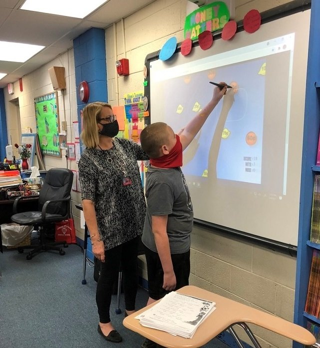 Sarah Maness, a teacher from Horace Maynard Middle School in Maynardville, Tennessee, is a 2021 UCOR grant recipient. Maness is shown introducing a student to a science, technology, engineering, and mathematics (STEM) project.