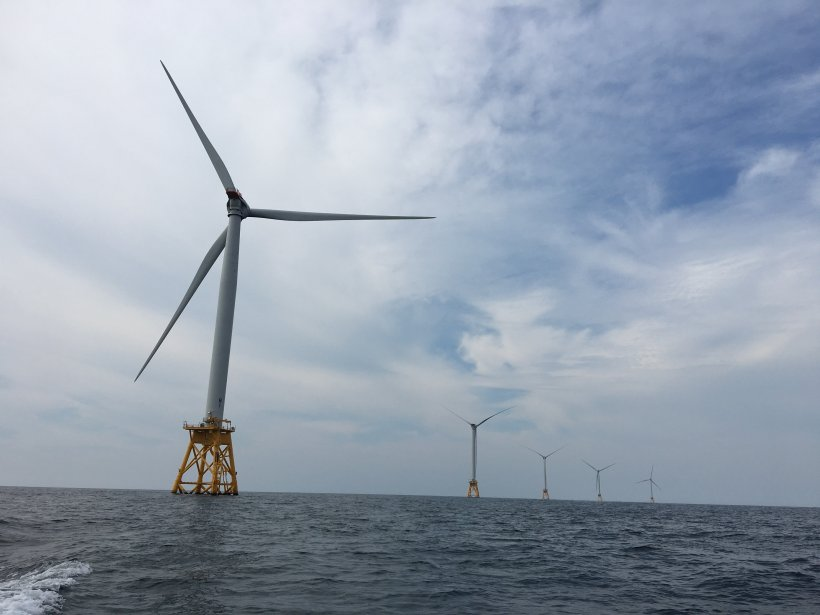 Photo of offshore wind turbines in the ocean at the Block Island Wind Farm.