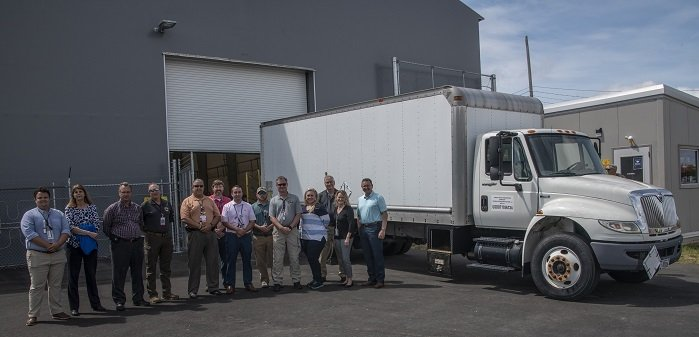 Members of the Savannah River Site K Area Characterization and Storage Pad team and their management celebrate the delivery of the first Criticality Control Overpack drum to the pad.