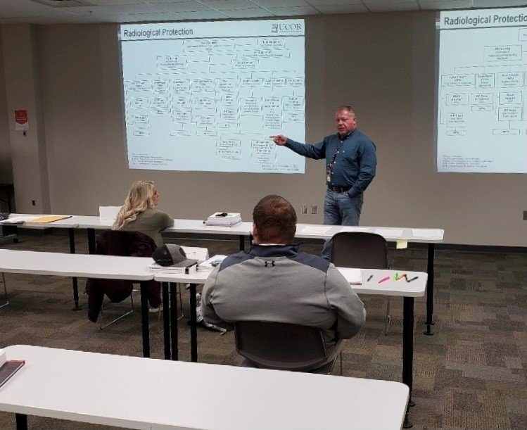 Chris Jones, UCOR training cadre manager, teaches Oak Ridge's future radiation protection technicians. The 13-week course features classroom, on-the-job, virtual reality, and simulated training environments for students to achieve proficiency.