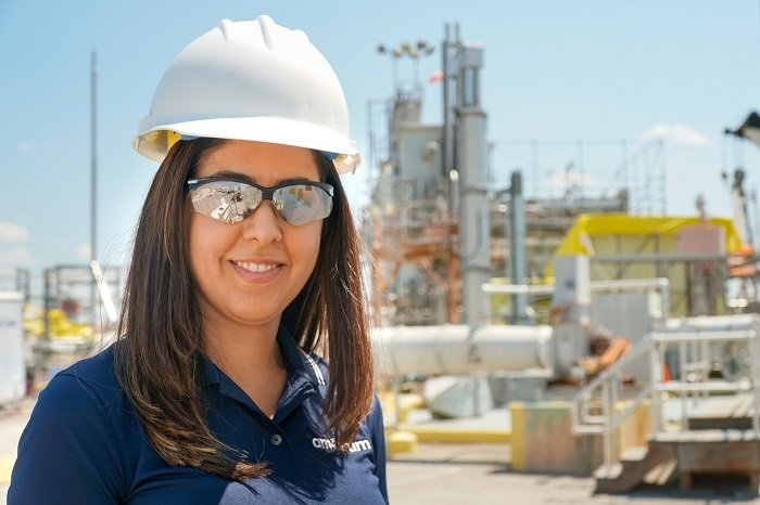 Savannah River Remediation Principal Engineer Azadeh Samadi-Dezfouli, pictured in front of a salt waste blend tank, manages salt and sludge batch qualification activities and schedules at the Savannah River Site to ensure batch qualification and delivery are timely.