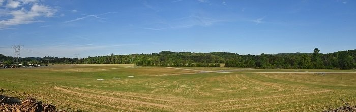 A view of a 21-acre portion of the Powerhouse Area at Oak Ridge where workers backfilled, contoured, and hydroseeded. This land is being proposed for future recreational development.
