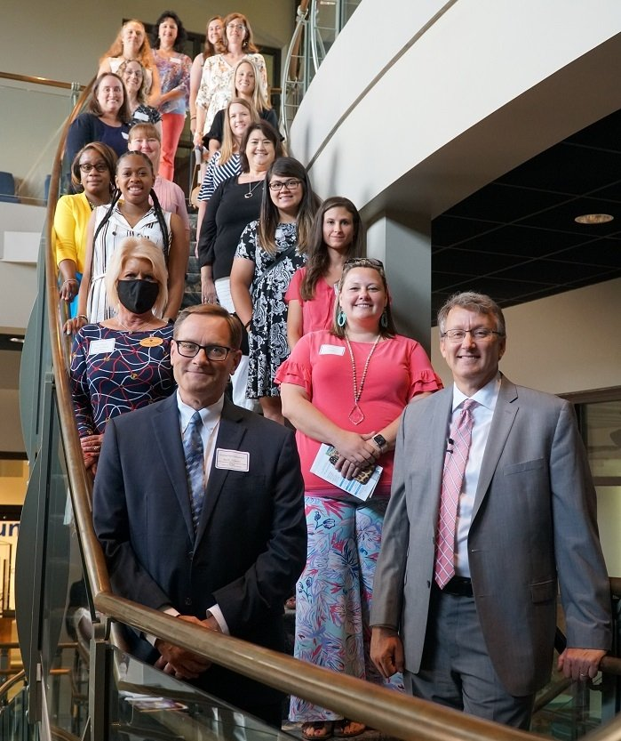 The 2021 SRR STAR grants totaled over $15,000 to help advance science, technology, engineering, and math (STEM) curriculum in elementary school classrooms. Most of the teachers who won grants are pictured here behind Breidenbach and Schmitz.