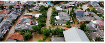 Residential homes surrounded by floodwater.