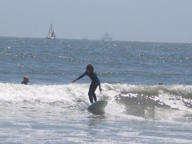 A boy surfing.
