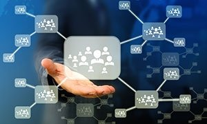 a person reaching out to a graphical representation of a social network