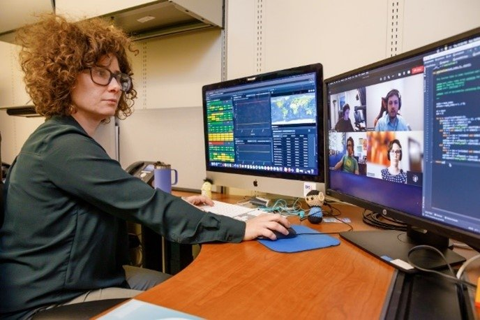 Kale Aur of Sandia National Laboaratories works with other software developers on the Station State-of-Health Monitoring capability recently released to the International Data Centre (IDC) in Vienna.