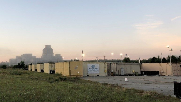 The Mobile Plutonium Facility during Relentless Rook at the Savannah River Site with P Reactor in background.