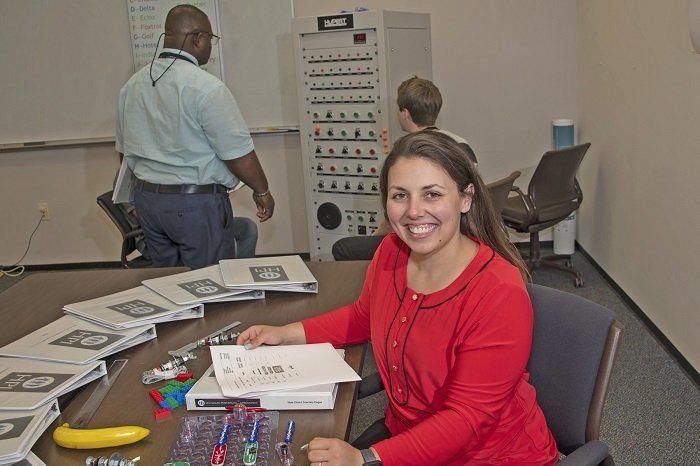 Cassie Sistare, a newly hired employee and former intern of Savannah River Nuclear Solutions (SRNS), evaluates a training session using a dynamic learning activity she developed during her internship. Dynamic learning activities raise employee safety awareness at EM's Savannah River Site.