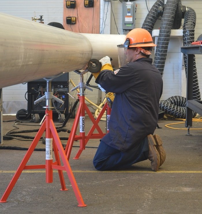 A North America's Building Trades Unions employee helps fabricate piping for upgrades to the Molten Salt Reactor Experiment facility at Oak Ridge National Laboratory.